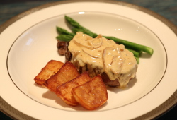 Ultimate fillet steak with a blue cheese sauce, sauté potatoes and asparagus.