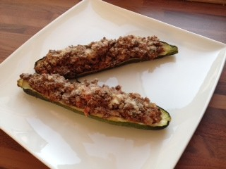 Courgettes stuffed with spicy lamb